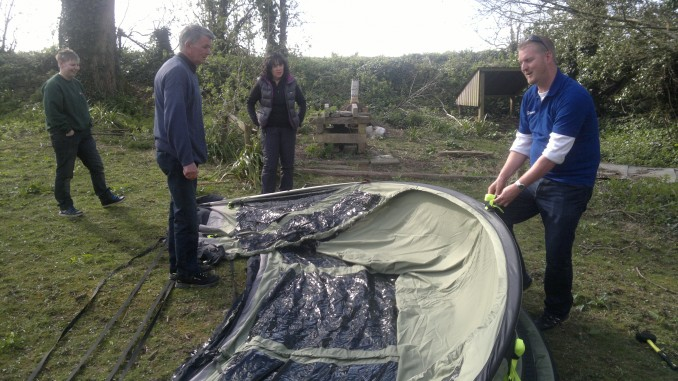 LIFT UP THE TENT BY THE POLES AND STRETCH OUT LENGTHWAYS UNTIL THE TENT HAS TAKEN SHAPE. & Outwell Tent Training